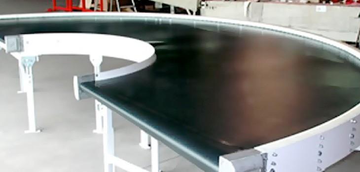 Powered belt curve conveyors